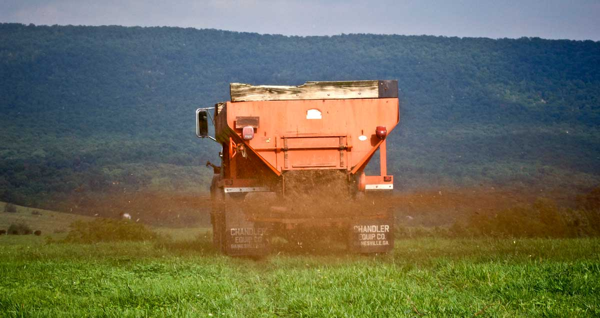 Farmers in Rockingham County, Virginia spread poultry litter in their fields.